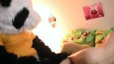 Redhead with panda bear