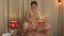 Rita oils up her huge juicy breasts on a big