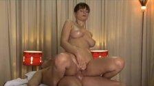 Rita oils up her huge juicy breasts on a big