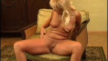 Blonde MILF masturbates with dildo