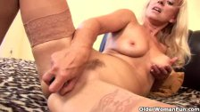 Senior blonde in stockings fucks a dildo