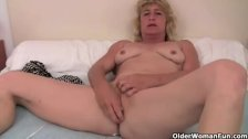 Grandma in heat fucks herself with a dildo