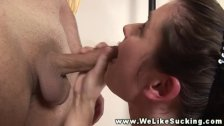 Hungry brunette sucking on dick