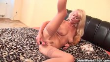 Granny with hanging tits works her old pussy