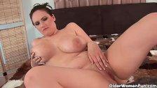 Mature mom gets cum shot on her big tits
