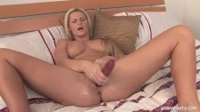 Busty Sandra masturbating with dildo