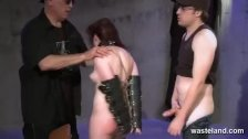 Brunette girl is shackled and spanked hard by