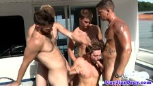 Andrew Blue with a few cocks at an orgy