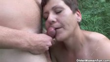 The outdoors wets grandma's appetite for cock