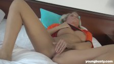 Busty young Jessie masturbating