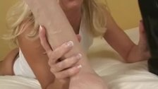 Blonde cougar pounds her ass with a big dildo