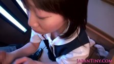 Tiny Japanese girl on knees sucking cock