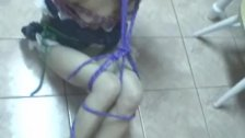 Tied up Asian lass with small boobies endures