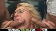 Old granny slut takes two cocks in the fields