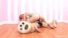 Brett Rossi plays with a stuffed bear