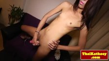 Petite thai ladyboy plays with her cock