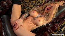 Busty blonde Sarah Jessie plays w/ her pussy