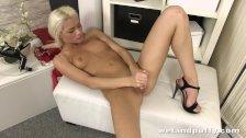 Slender blonde girl drilling her pussy