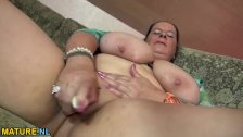 Mature lady oiling up her tits and toying