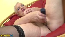 Granny undressing and playing with her pussy