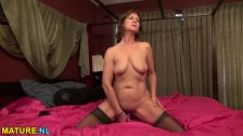 Mature taking off her lingerie and toying