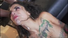 Tattoed Beauty Sucking Two Dicks