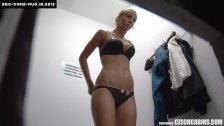 Beautiful Girl Wearing Clothes in Store