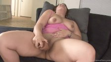 Foxy busty babe masturbating with a vibrator