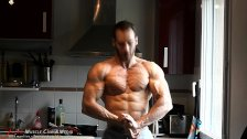 Naked strength and muscle twists a frying pan