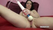 Gianna Love is playing with two toys
