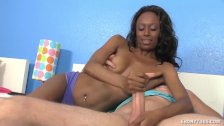 Topless ebony strokes a big prick
