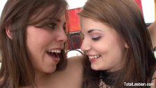 Brunette stepsisters masturbate together on the couch