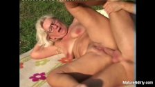 Blonde grandma gets some cum on her glasses