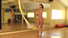 Cute gymnast girl performs cool escercises