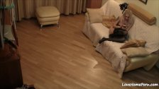 Girl in black stockings masturbates on the couch