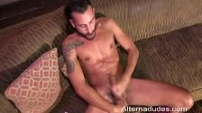 Long Haired Stud Jacks His Curvy Cock