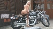 Hot blonde bimbo poses on a motorbike