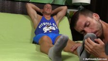 Muscular dude gets feet and toe licked