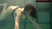 Blackhaired beauty Irina underwater