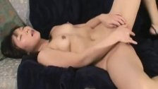 Asian wife strips and sensually fondles her neatly trimmed slit