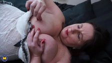 Huge titted brunette mature sucks her nipples