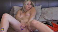 Natural blonde mature fingers herself