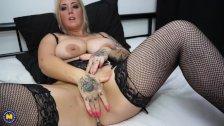 Blonde tattooed MILF undressing and masturbating