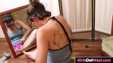 Hairy chick Rosie squirts in front of the mirror