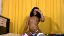 Playful black tranny strips white longerie and jerks shecock