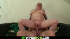 Busty mother-in-law rides on his cock