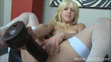 Petite blonde brutalizes both her holes with big dildos