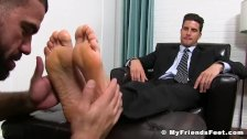 Classy jock in suit enjoying is some sloppy feet sucking