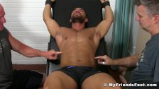 Muscular hunk enjoys a good tickle