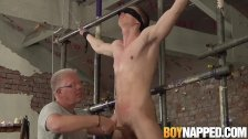 Blindfolded sub twink gets a handjob by mature perv